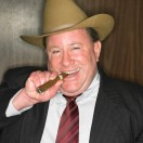 Businessman with Cowboy Hat and Cigar